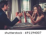 beautiful couple in a restaurant | Shutterstock . vector #691194007