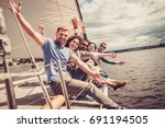 happy friends resting on a yacht | Shutterstock . vector #691194505
