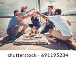 happy friends eating fruits and ...   Shutterstock . vector #691195234