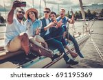 happy friends taking selfie on... | Shutterstock . vector #691195369