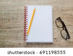 blank notebook with glasses and ... | Shutterstock . vector #691198555