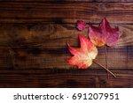 Autumn Leaves Over Dark Wooden...