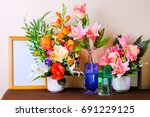 empty photo frame with flower...   Shutterstock . vector #691229125