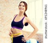 young happy woman in spotwear... | Shutterstock . vector #691248961