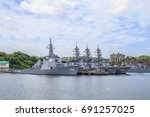 Small photo of YOKOSUKA, JAPAN - MAY 4, 2017: A squadron of Japan Maritime Self-Defense Force Aegis guided missile destroyers are moored closely together at the huge Yokosuka Naval Port.