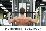 young muscular man exercising... | Shutterstock . vector #691259887