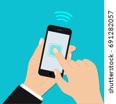 hand holding mobile phone in... | Shutterstock .eps vector #691282057