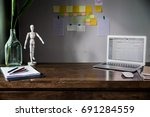 dark wood working table in... | Shutterstock . vector #691284559
