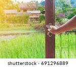 women hand open door to the... | Shutterstock . vector #691296889