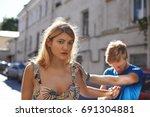 desperate sad guy in blue t... | Shutterstock . vector #691304881