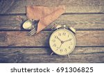 retro metal alarm clock and... | Shutterstock . vector #691306825