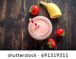strawberry and banana smoothie. ... | Shutterstock . vector #691319311