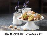 sweet homemade cannoli stuffed... | Shutterstock . vector #691321819