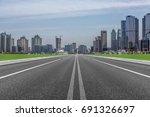 city road through modern...   Shutterstock . vector #691326697