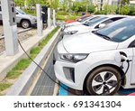 electric car charging station... | Shutterstock . vector #691341304