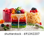 Various Slices Of Cakes On A...