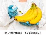 gmo scientist injecting liquid... | Shutterstock . vector #691355824
