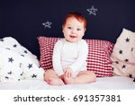 cute infant baby waking up in... | Shutterstock . vector #691357381