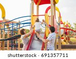 playful child with parents at... | Shutterstock . vector #691357711