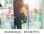 man's hand open the door with... | Shutterstock . vector #691367071
