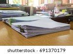 stacks of papers. | Shutterstock . vector #691370179
