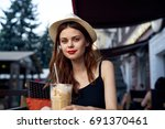 woman resting in a cafe  latte... | Shutterstock . vector #691370461
