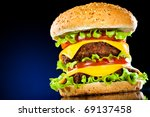 Tasty and appetizing hamburger on a dark blue background - stock photo