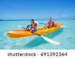two happy boy and girl kayaking ...   Shutterstock . vector #691392364