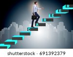 businessman climbing career... | Shutterstock . vector #691392379