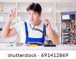 computer repairman repairing...   Shutterstock . vector #691412869