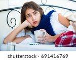 young brunette having influenza ... | Shutterstock . vector #691416769