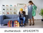 bored man shopping with his...   Shutterstock . vector #691423975