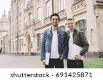 two friends are staying near...   Shutterstock . vector #691425871
