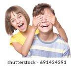 teen girl covering boy's eyes...   Shutterstock . vector #691434391