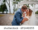 fabulous young wedding couple... | Shutterstock . vector #691440355