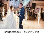newly married couple dancing on ... | Shutterstock . vector #691440445