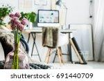 violet flowers in glass vase in ...   Shutterstock . vector #691440709