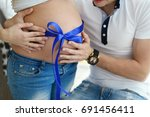 pregnant woman with her husband.... | Shutterstock . vector #691456411