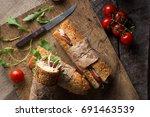 delicious sandwiches on a dark... | Shutterstock . vector #691463539