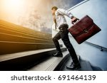 businessman leap up the stairs... | Shutterstock . vector #691464139
