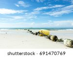 beach  sea and sky. | Shutterstock . vector #691470769