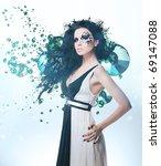 Black splatter woman in dress and rhinestones on shiny background - stock photo