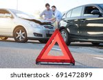 two men reporting a car crash... | Shutterstock . vector #691472899