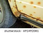 hole in threshold of old car ... | Shutterstock . vector #691492081