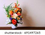 flower vases on table   Shutterstock . vector #691497265