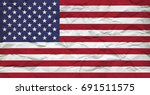 usa flag on crumbled paper sheet | Shutterstock . vector #691511575