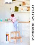 cute toddler baby climbs on... | Shutterstock . vector #691514155