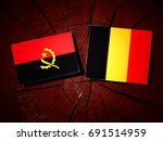 Small photo of Angolan flag with Belgian flag on a tree stump isolated