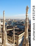 Landscape panoramic view of Milan from Duomo cathedral roof, Royal Palace in background, Lombardy, Italy - stock photo