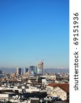 Landscape panoramic view of Milan from Duomo cathedral roof, skyscrapers district in background, Lombardy, Italy - stock photo